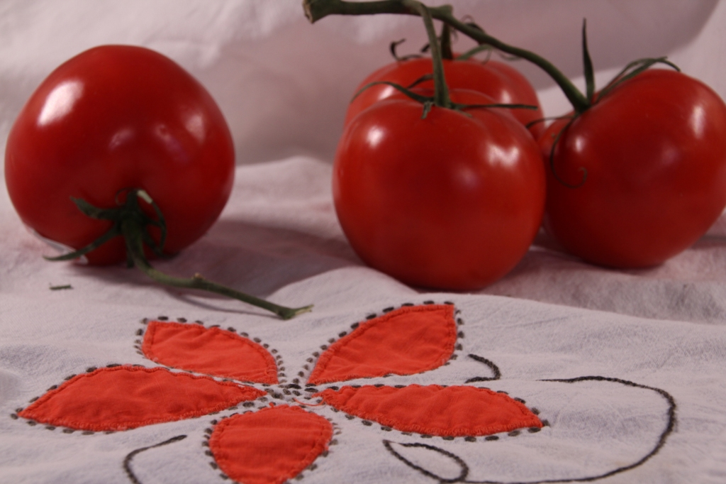 tomatoes and dish towel